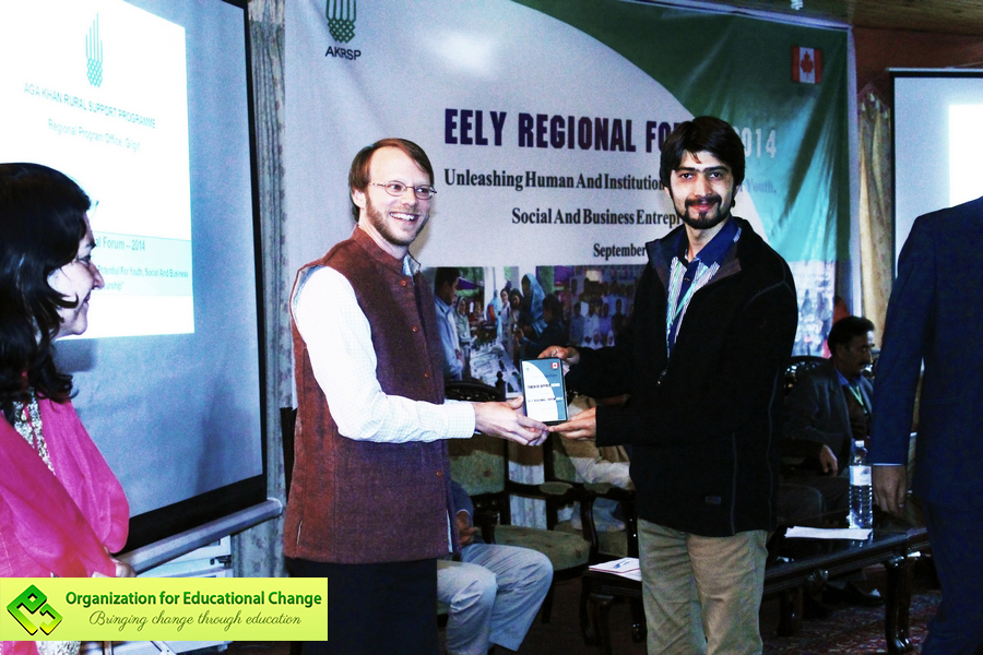 Imran Hunzai, OEC's Co-founder and former Vice President receiving the award from AKRSP Geneva representative